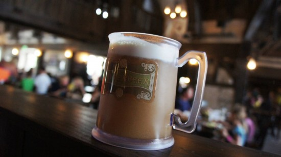 Butterbeer in a souvenir cup from the Wizarding World of Harry Potter.