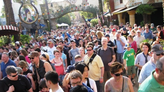 Actual crowds rushing into the Wizarding World of Harry Potter.