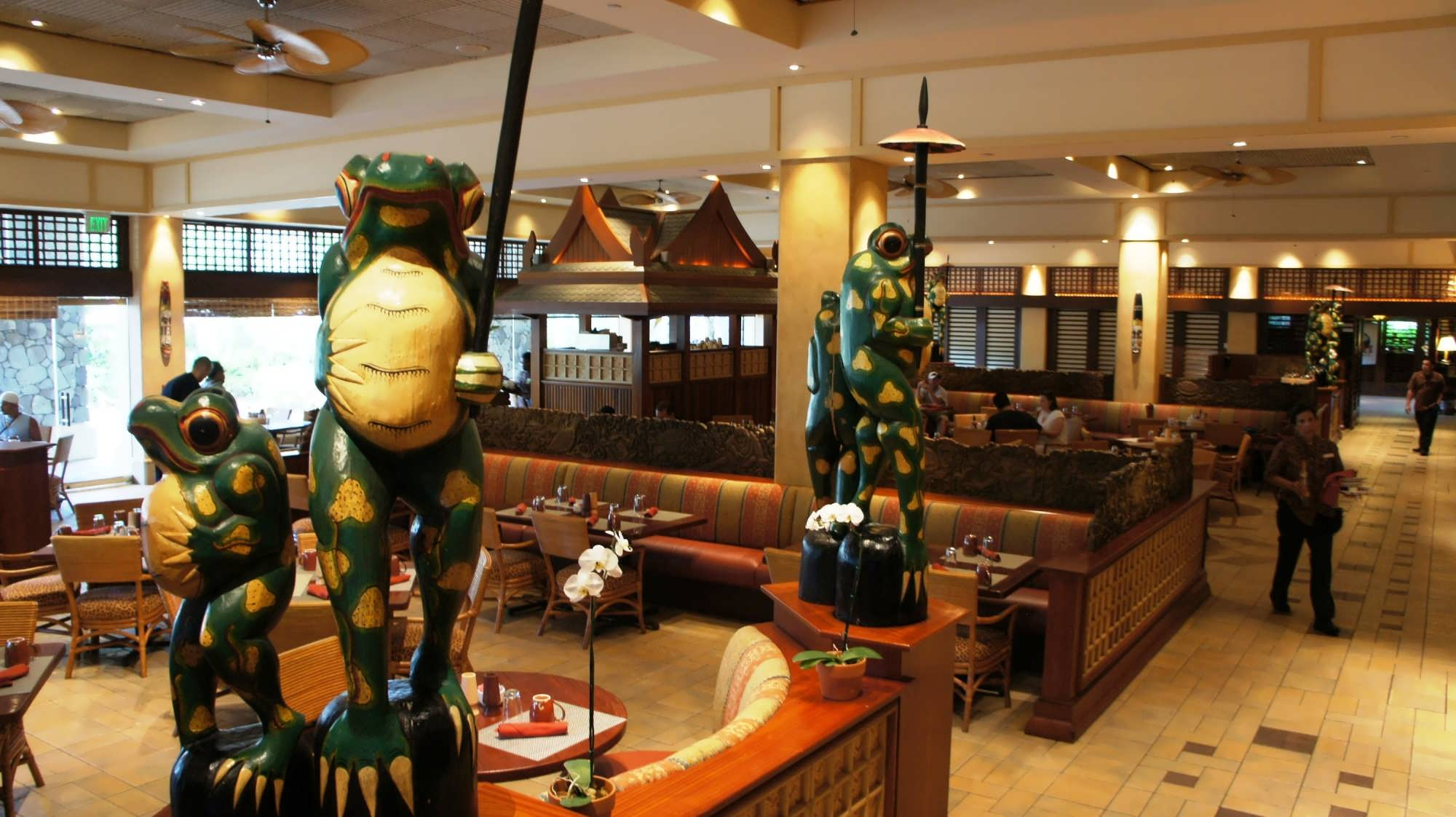 The seating around at Islands Dining Room with tables, booths and South Pacific decor