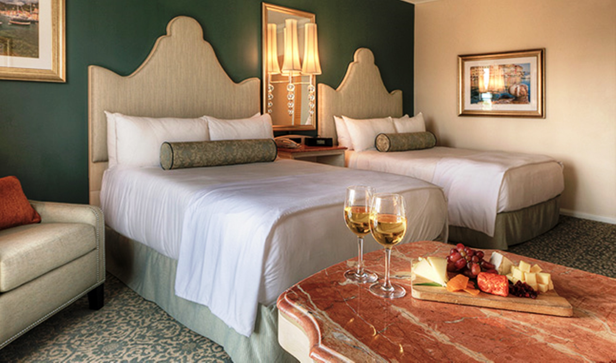 A garden-view room at Portofino Bay Hotel with two queen beds