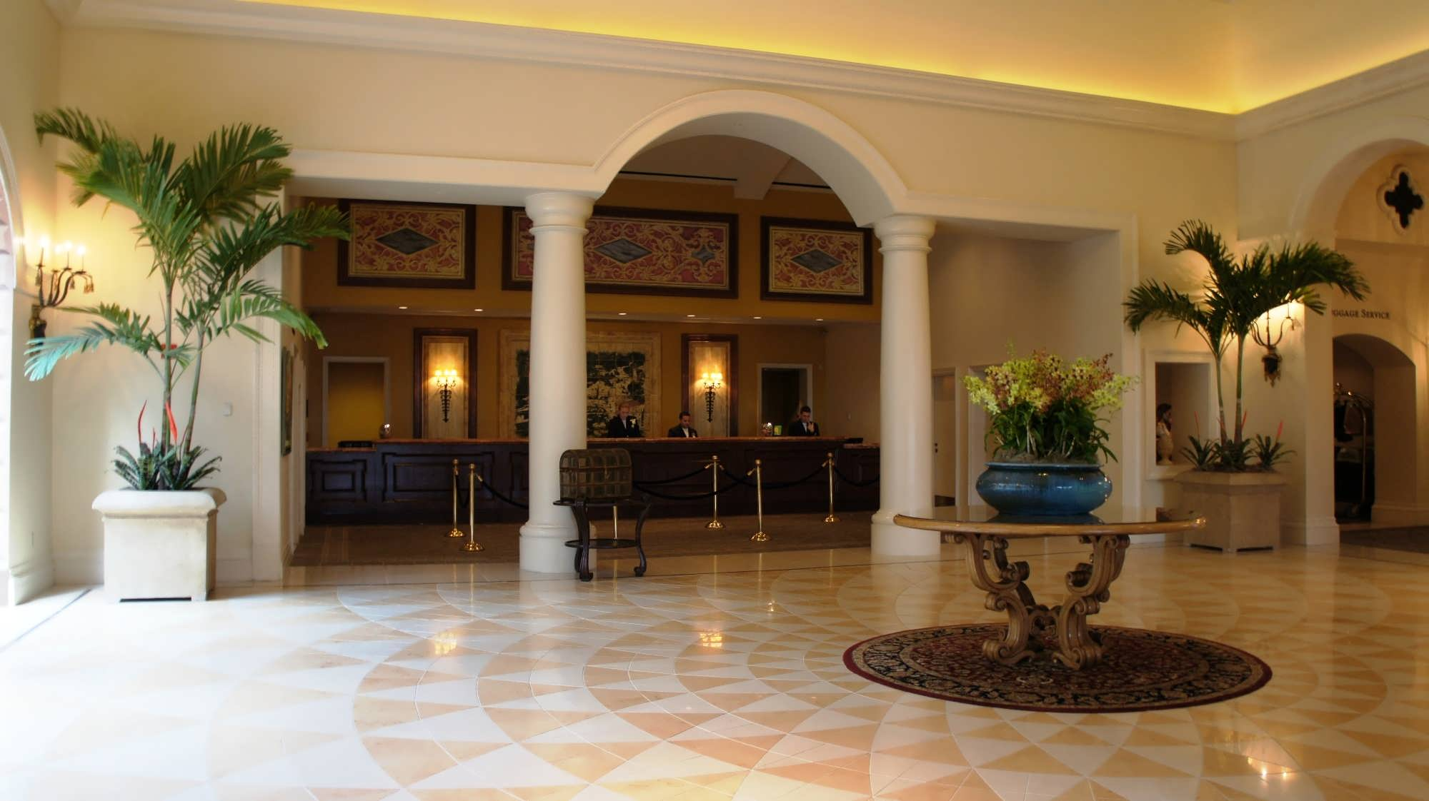 Marble floors adorn the lobby and the recessed check-in desk at Portofino Bay