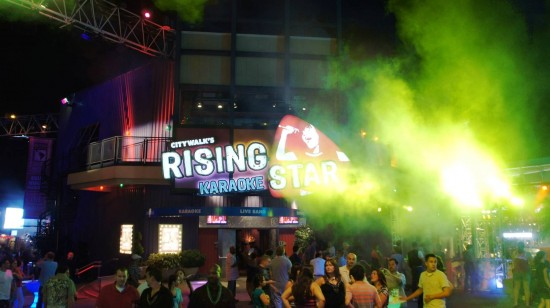 Universal CityWalk at night: Party goers in front of Rising Star.