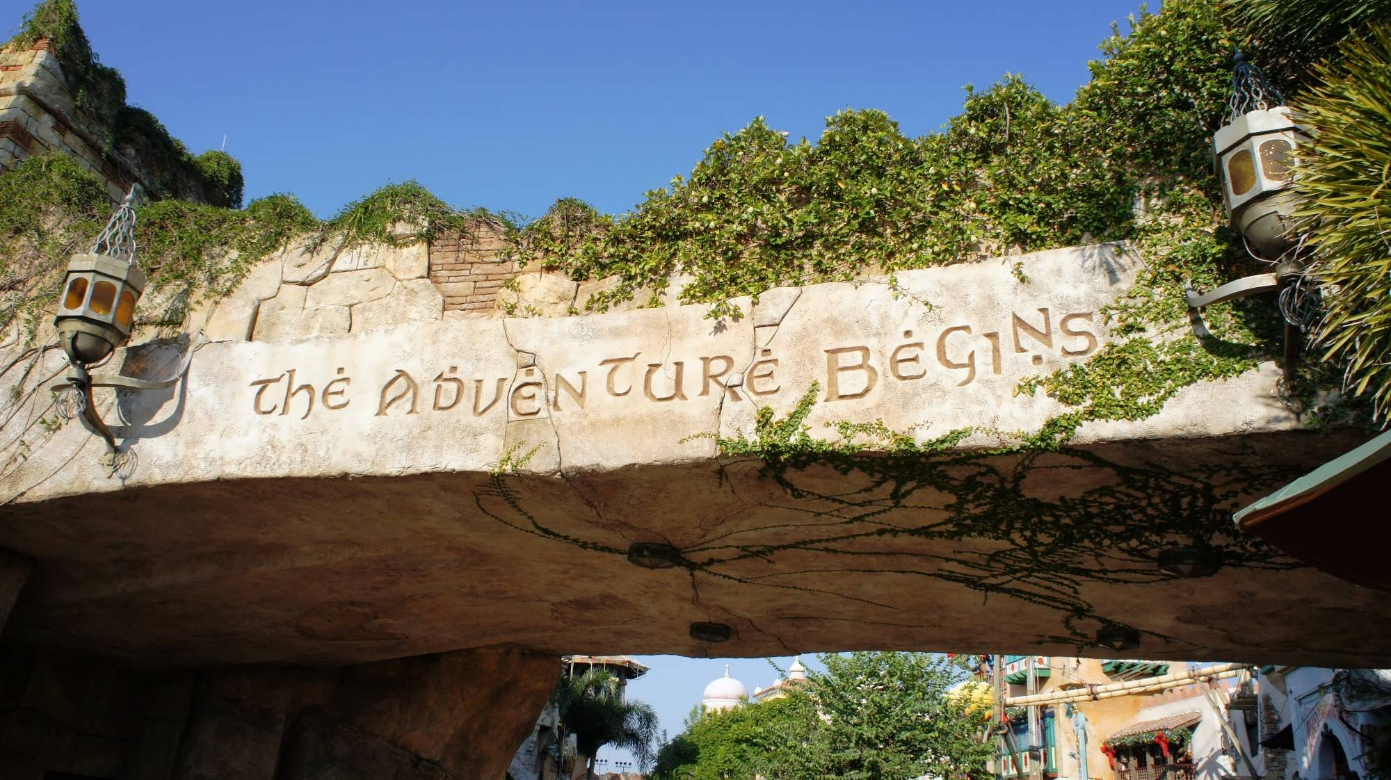 A stone archway welcomes guests to Islands of Adventure and reads