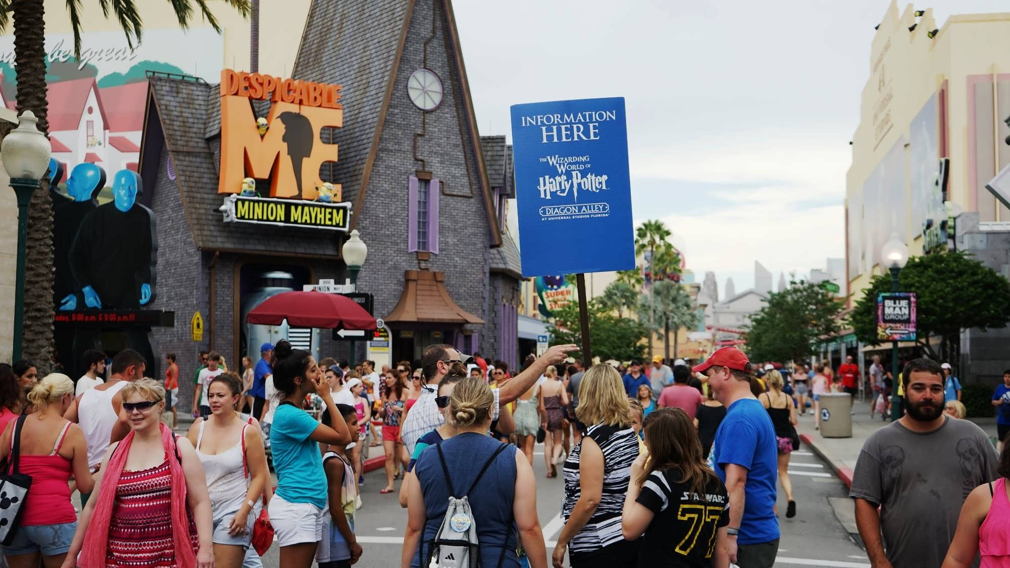 Team Members assisting with Diagon Alley directions