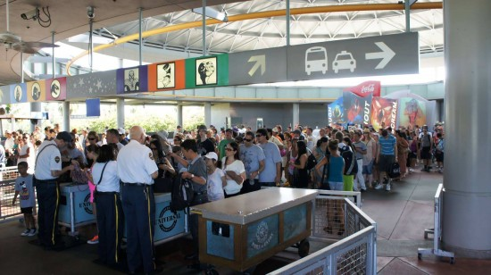 Security checkpoint at Universal's transportation hub on a busy summer morning.