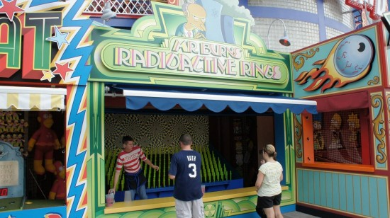 Carnival games in front of The Simpsons Ride at Universal Studios Florida.