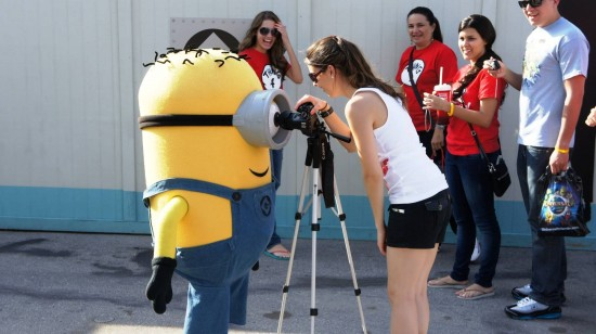 A minion from Despicable Me greets a guest.