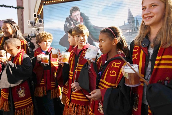 Children drinking butterbeer at the Tuesday news conference (courtesy of latimes.com).