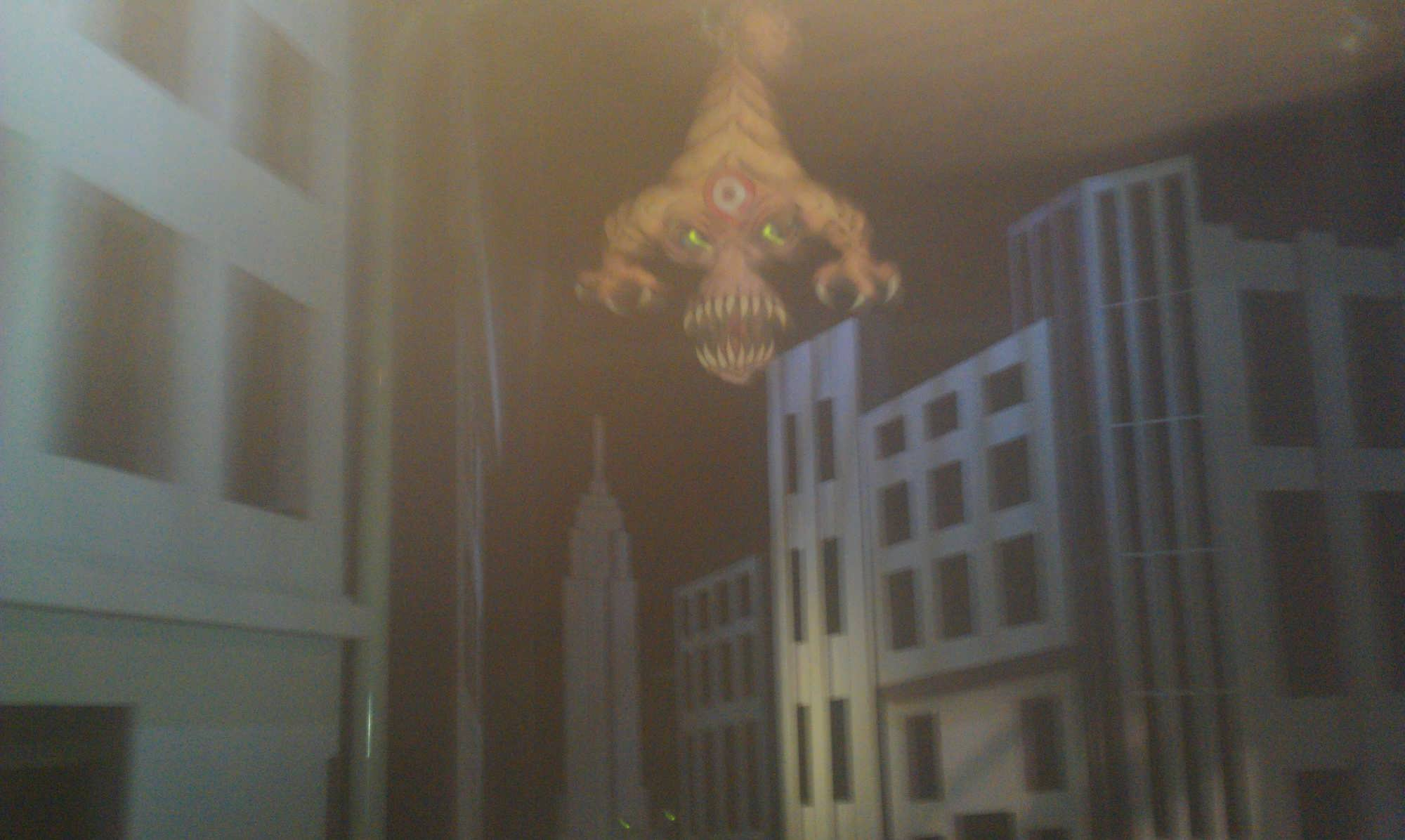Alien targets hang from the ceiling in Men in Black: Alien Attack