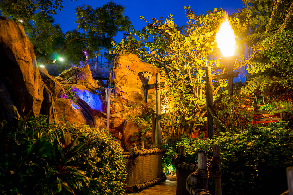 Camp Jurassic features water and fire effects, along with winding paths and bridges.