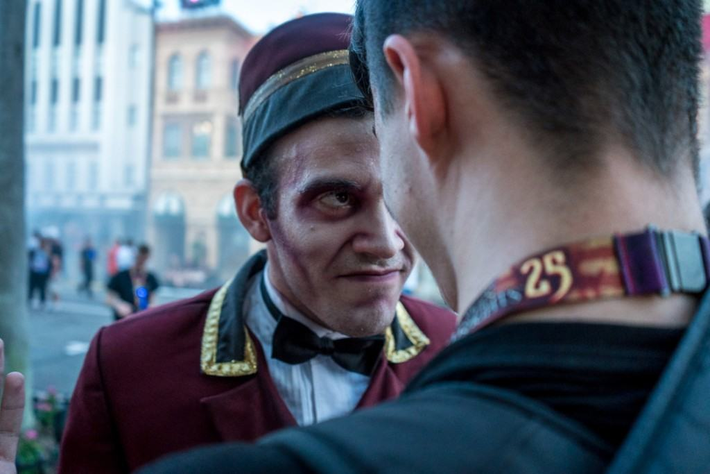 A scareactor at Halloween Horror Nights 25 gets up close and personal with a guest.