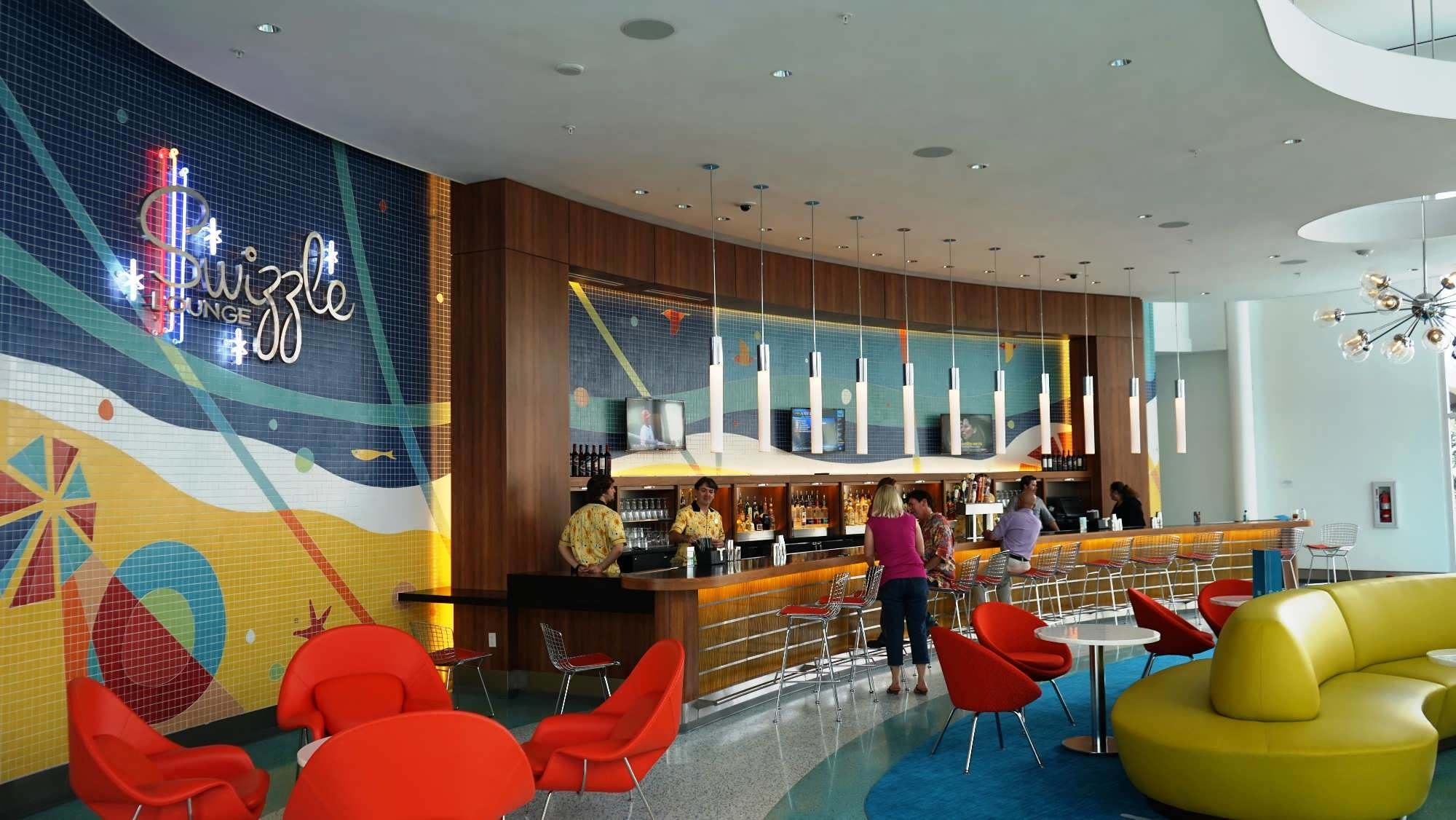 Bartenders at Swizzle Lounge mix up drinks in the lobby of Universal's Cabana Bay Beach Resort