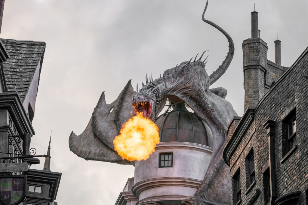 Most photos are a bust when it comes to a cloudy sky. In this case, the clouds seem to add the perfect mood to an already angry-looking dragon showing off her fire-breathing.