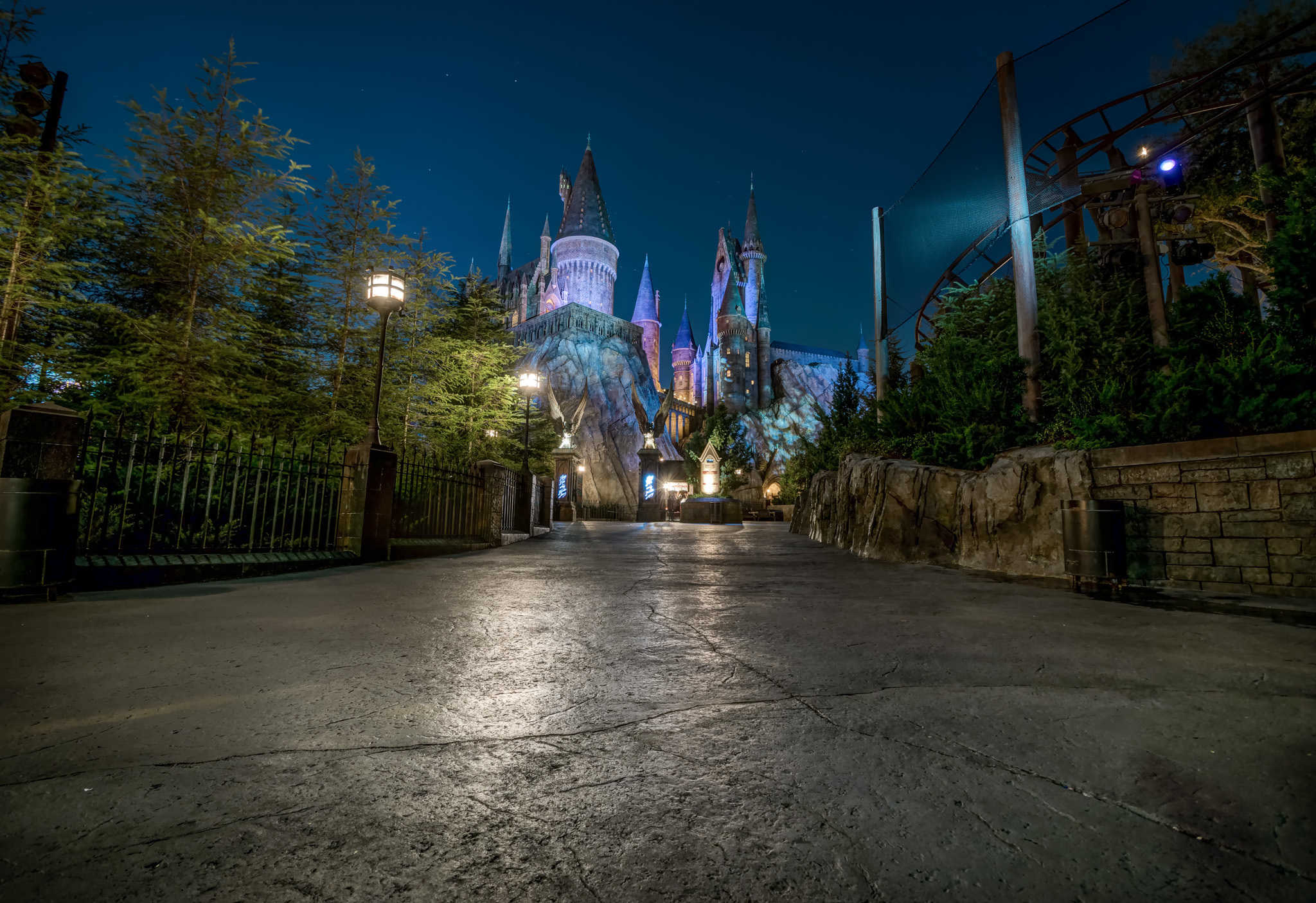 6 photos of an empty Wizarding World at night