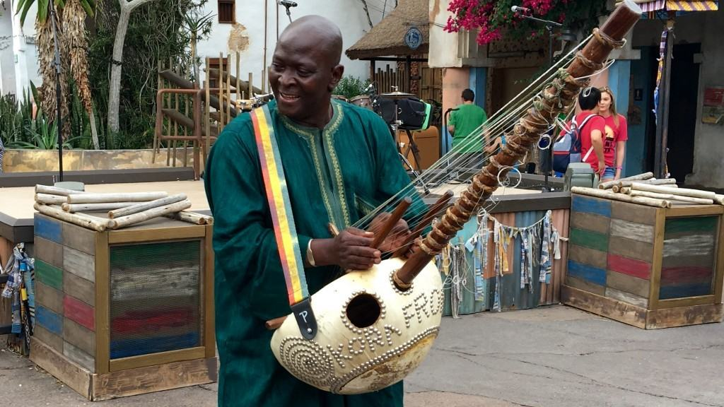 An artist playing the kora at the Harambe Wildlife Parti at Disney's Animal Kingdom