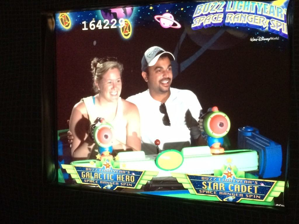 Photo of me and my wife in Buzz Lightyear's Space Ranger Spin ride.
