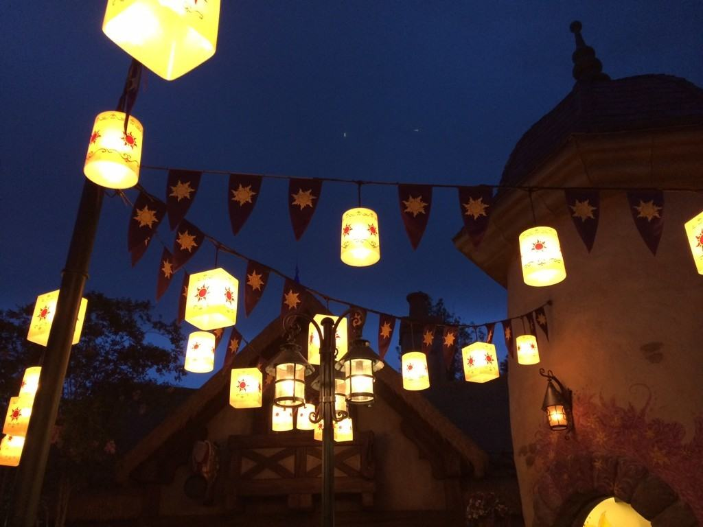 Lanterns hanging from strings in Fantasy Land at night.