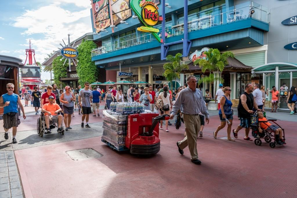 Universal Orlando Team Members distribute bottled water while transportation hub is closed