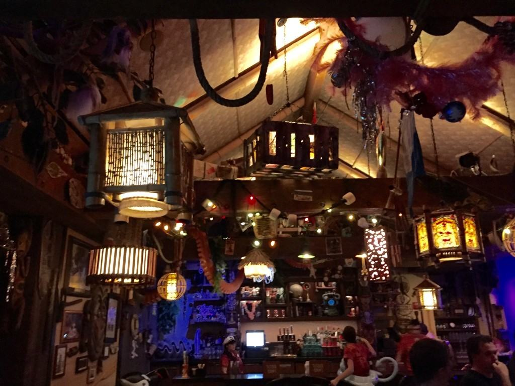 Inside Trader Sam's Grog Grotto adorned with Tiki Hut decorations including an octopus arm hanging from the ceiling.