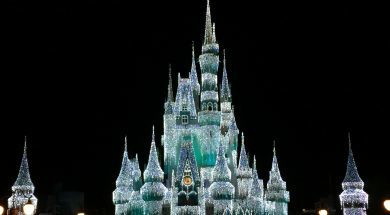 Cinderella's castle at night lit up with bright white lights.