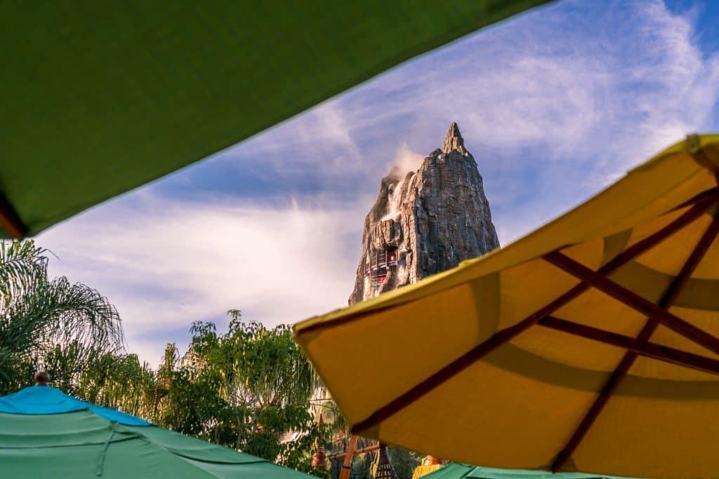 Peeking through Waturi Beach umbrellas towards Krakatau