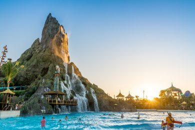 The sun sets on Waturi Beach at Universal's Volcano Bay