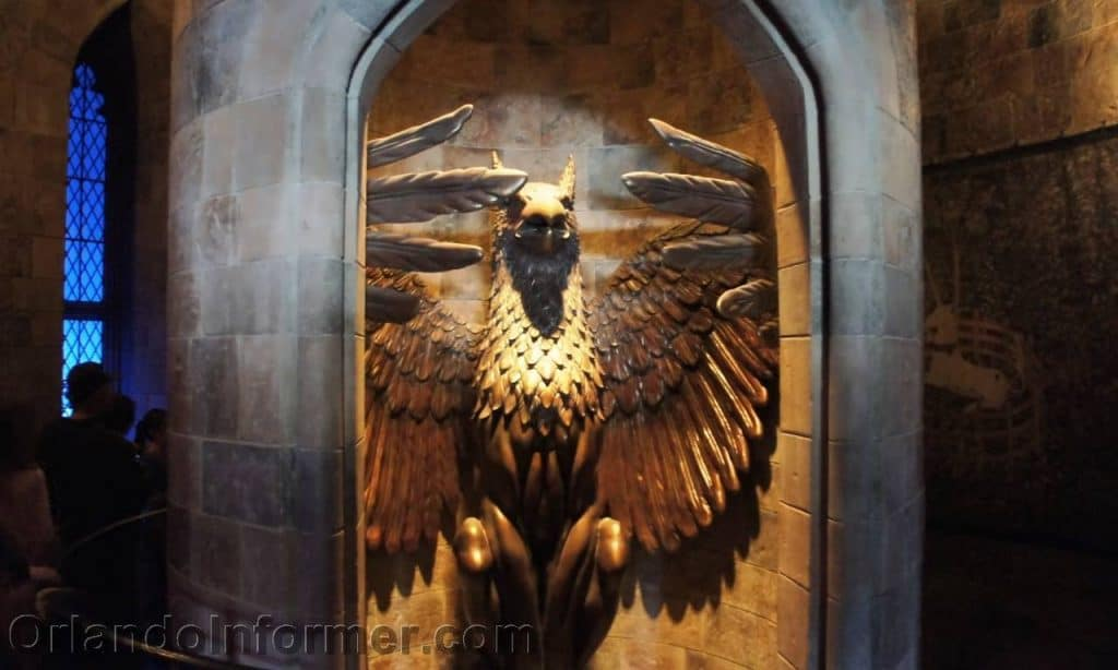 A winged creature statue guards the entrance to Dumbledore's office