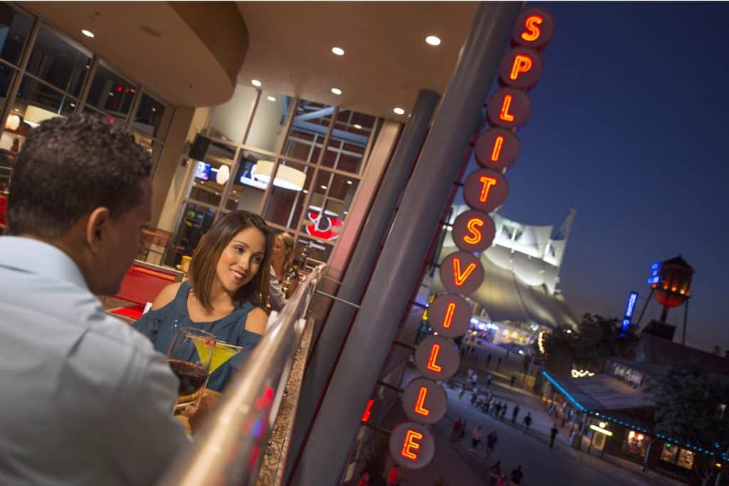 Photo of two people enjoying a drink at Splitsville in Disney Springs.