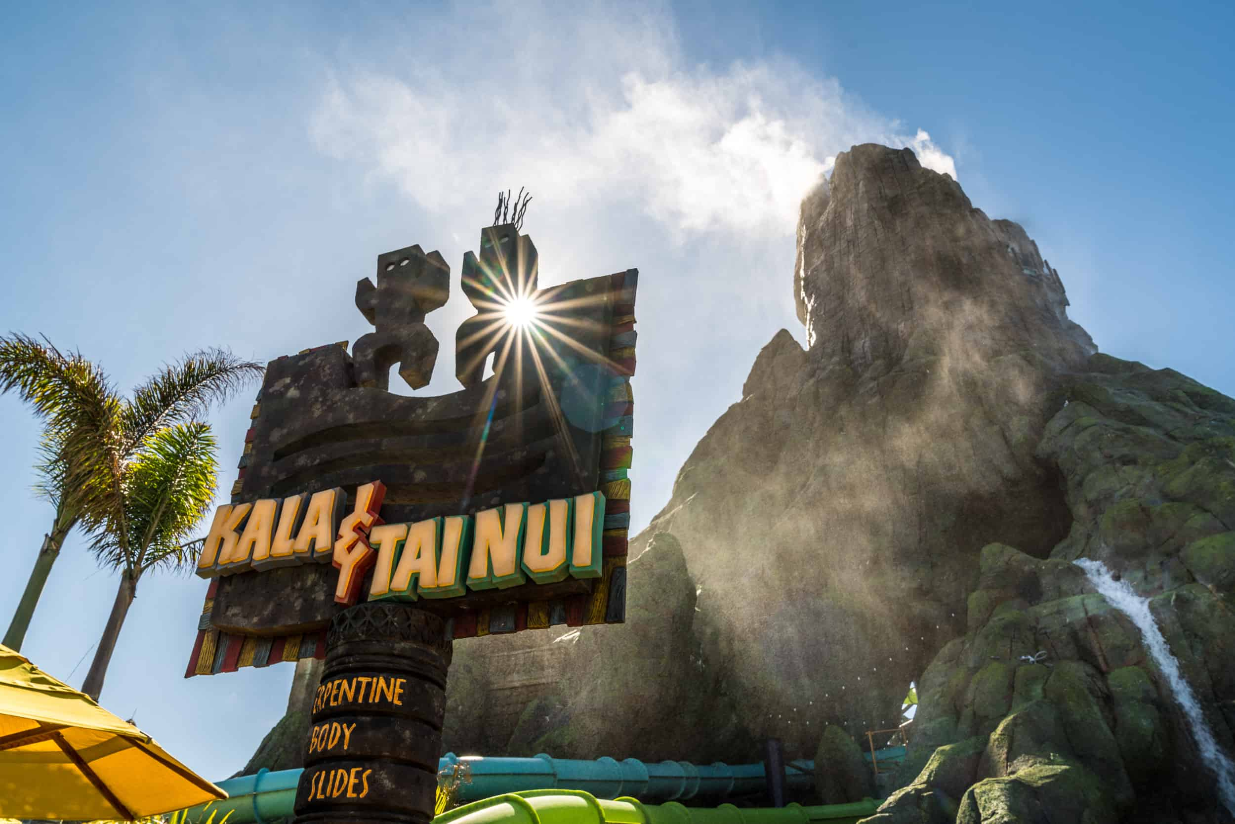 The entrance sign for Kala and Tai Nui Serpentine Body Slides in front of the volcano, Krataktau at Volcano Bay