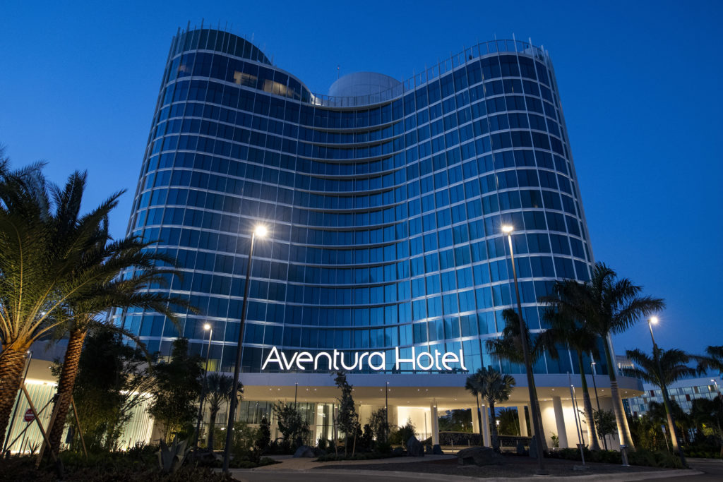 The unique curved shaped of Aventura Hotel at Universal Orlando Resort at twilight