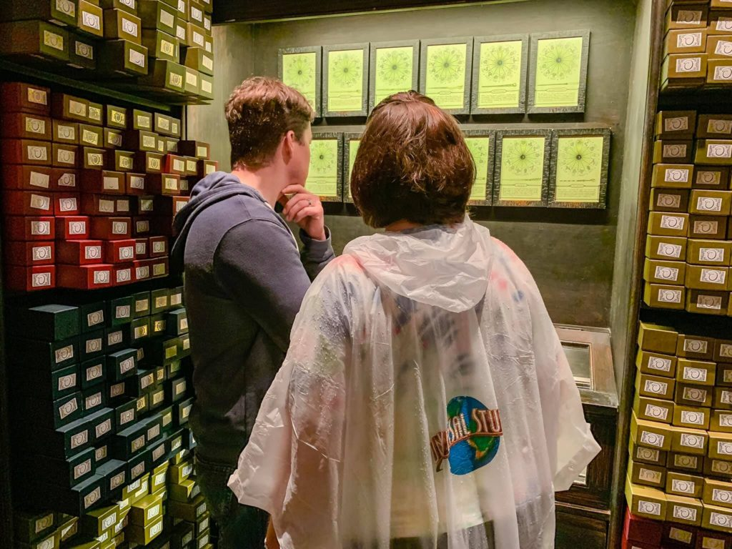 Choosing wands at Ollivander's at The Wizarding World of Harry Potter - Diagon Alley