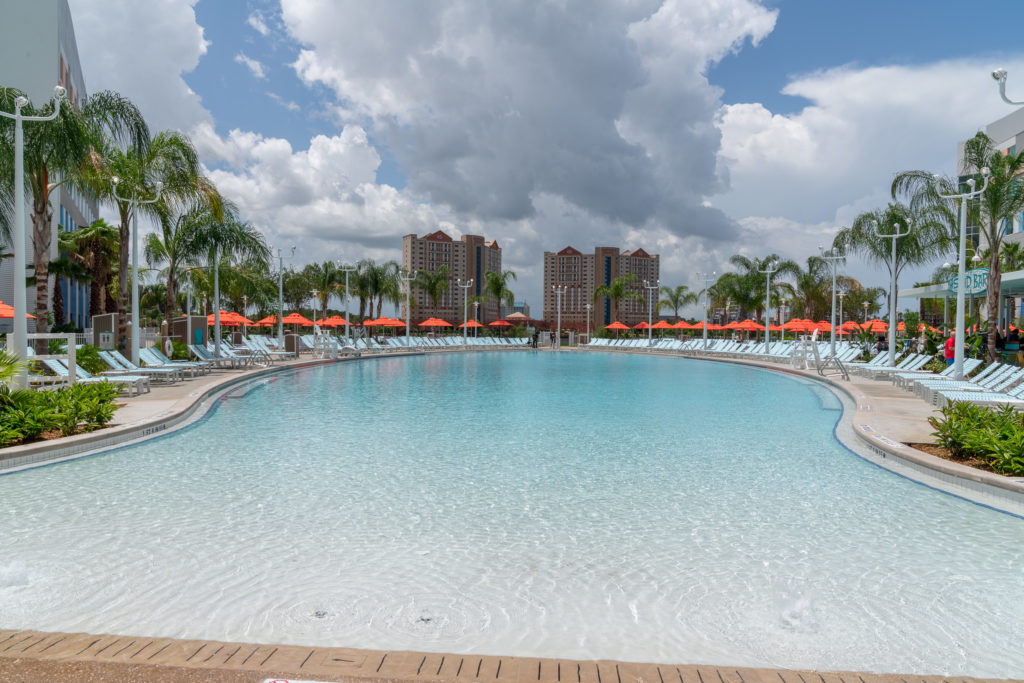 Relax at the zero-entry surfboard-shaped pool at Surfside Inn and Suites