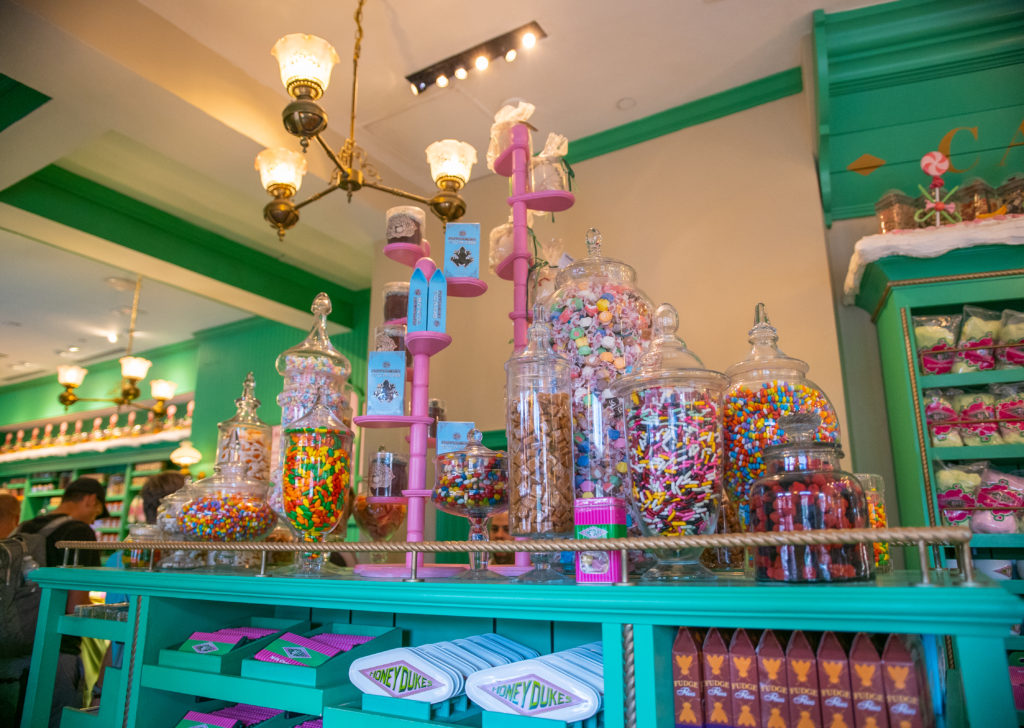 Honeydukes interior decor features towering displays of sweet treats