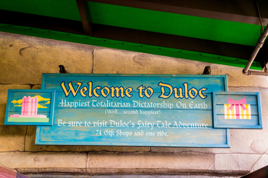 """A sign at Shrek 4D welcomes guests to Duloc - the """"happiest totalitarian dictatorship on Earth"""""""