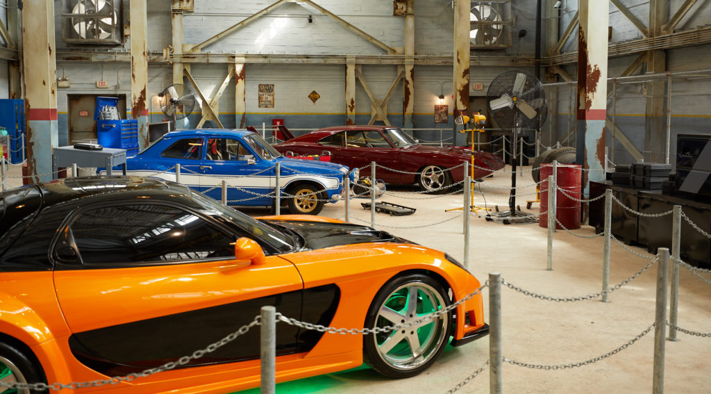 Some of the cars on display in the Fast & Furious – Supercharged queue