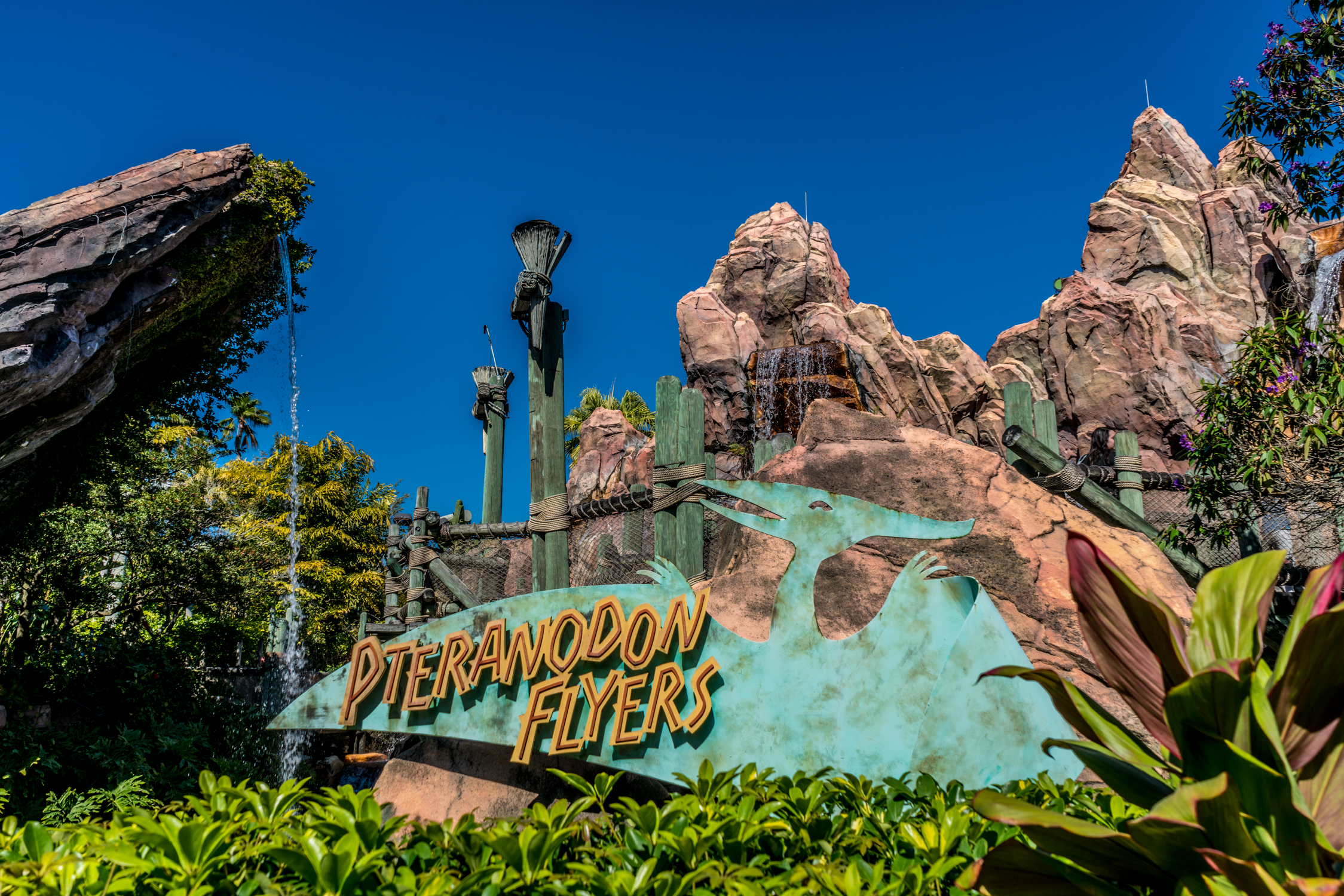The entrance to Pteranodon Flyers at Islands of Adventure is located inside Camp Jurassic