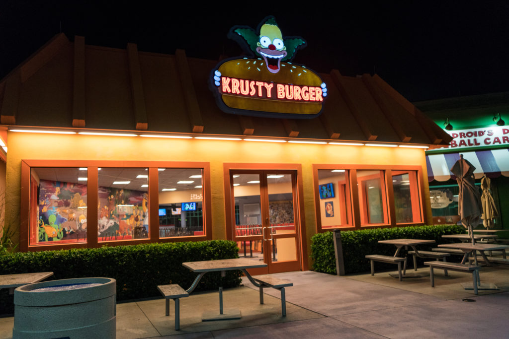 The Krusty Burger entrance to Fast Food Boulevard has the iconic Krusty Burger sign