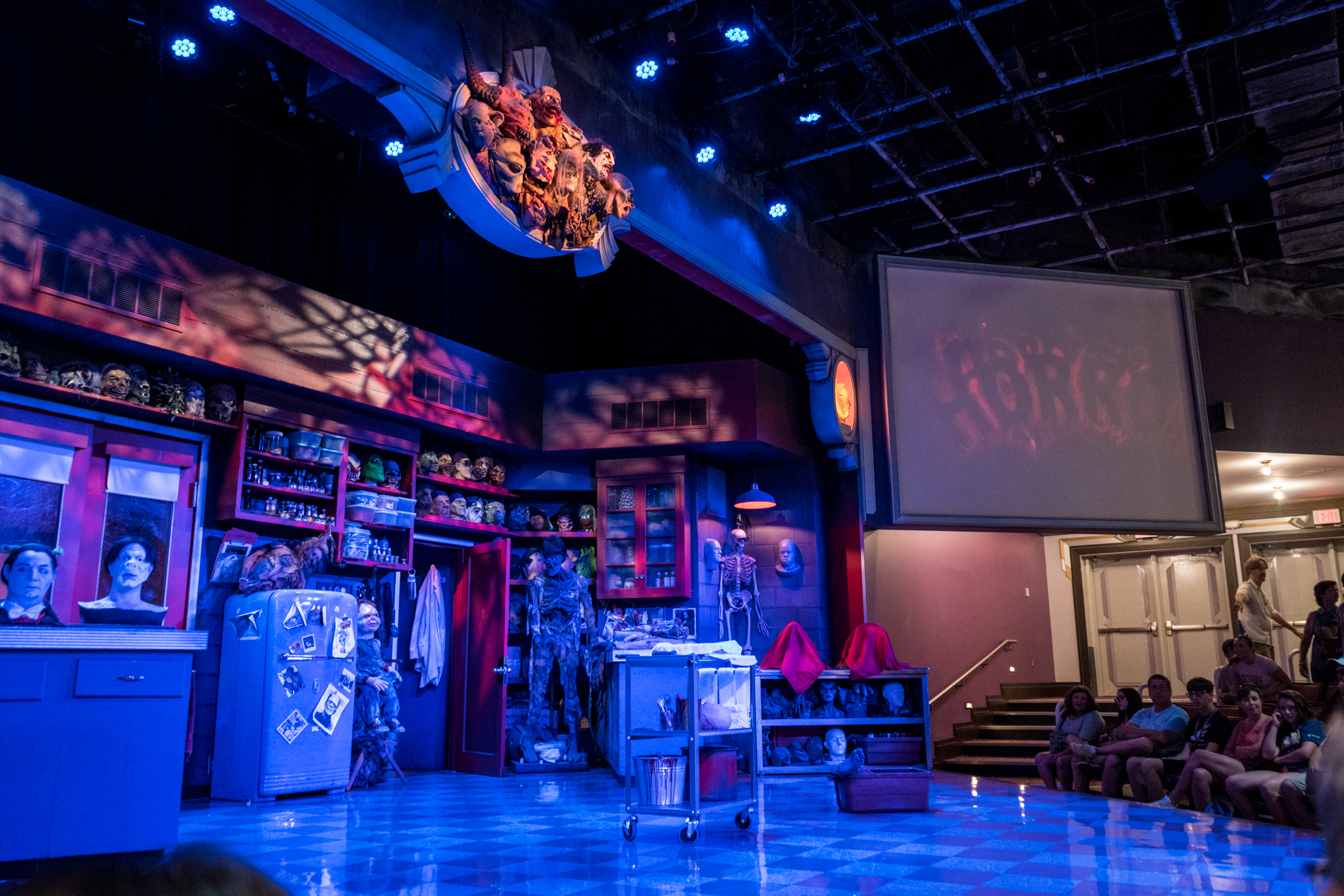 The stage for Universal Orlando's Horror Make-Up Show resembles a creative laboratory with lots of props and prosthetic masks from famous horror films