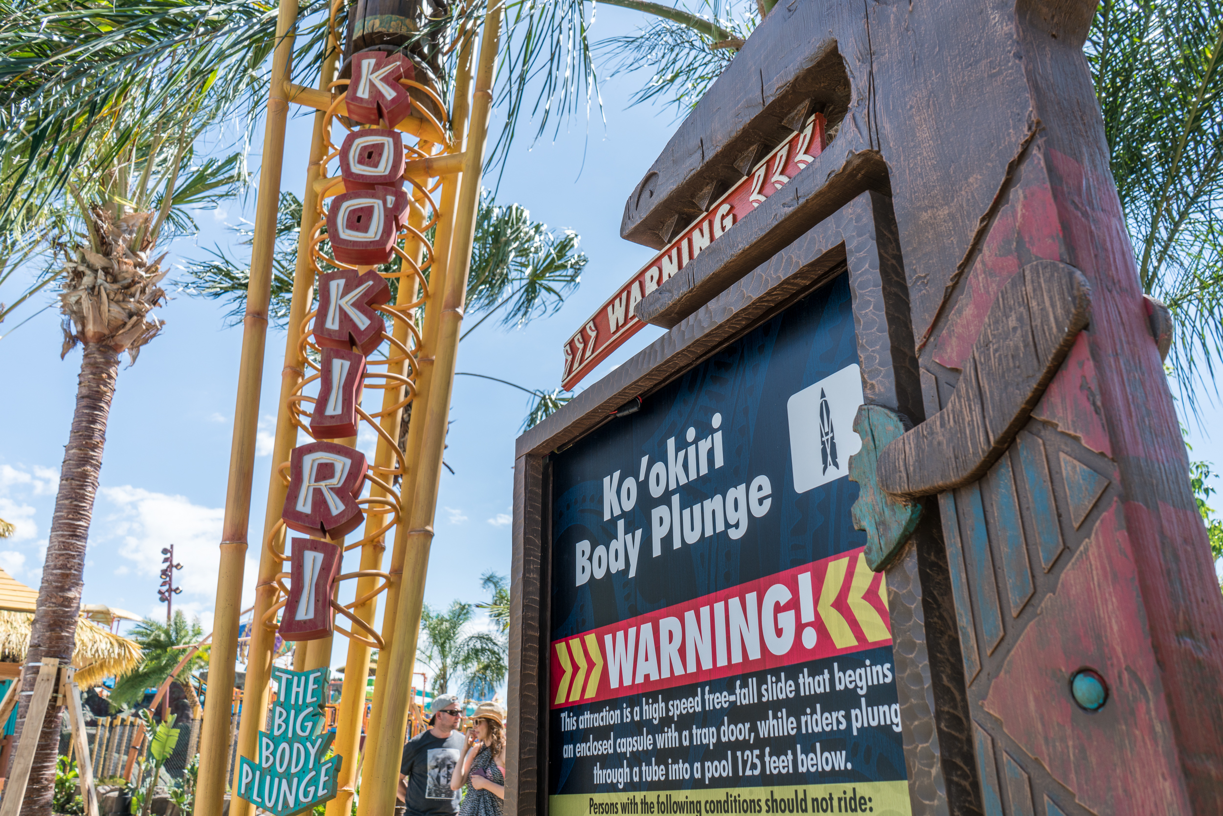 A warning sign prominently displayed outside Ko'okiri Body Plunge