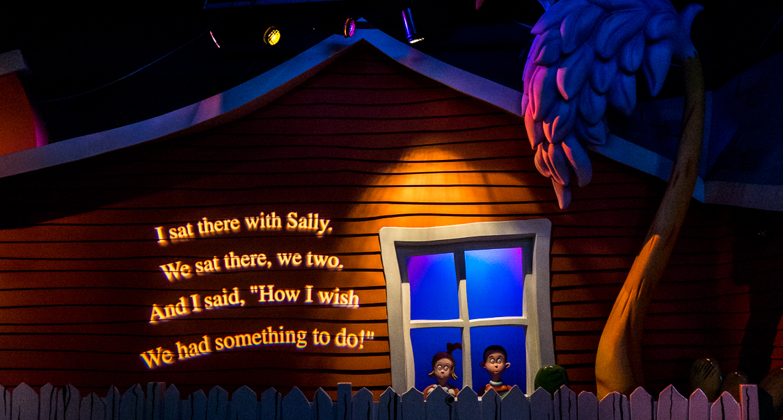 "Excerpts from the book are incorporated into the ride design, where a projection on the wall reads ""I sat there with Sally. We sate there, we two. And I said, 'How I wish we had something to do'"""