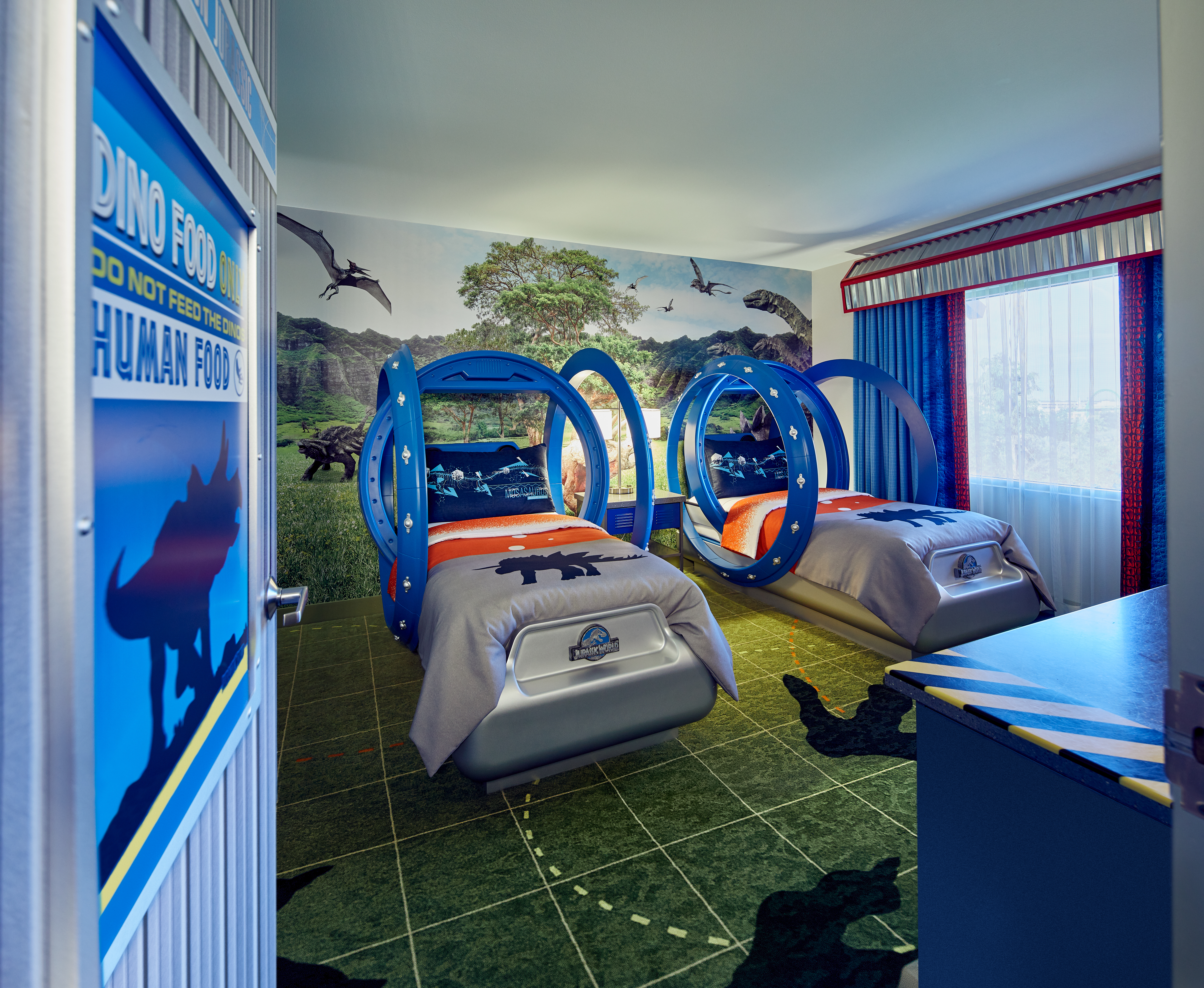 The kids room themed to Jurassic World with gyrosphere beds