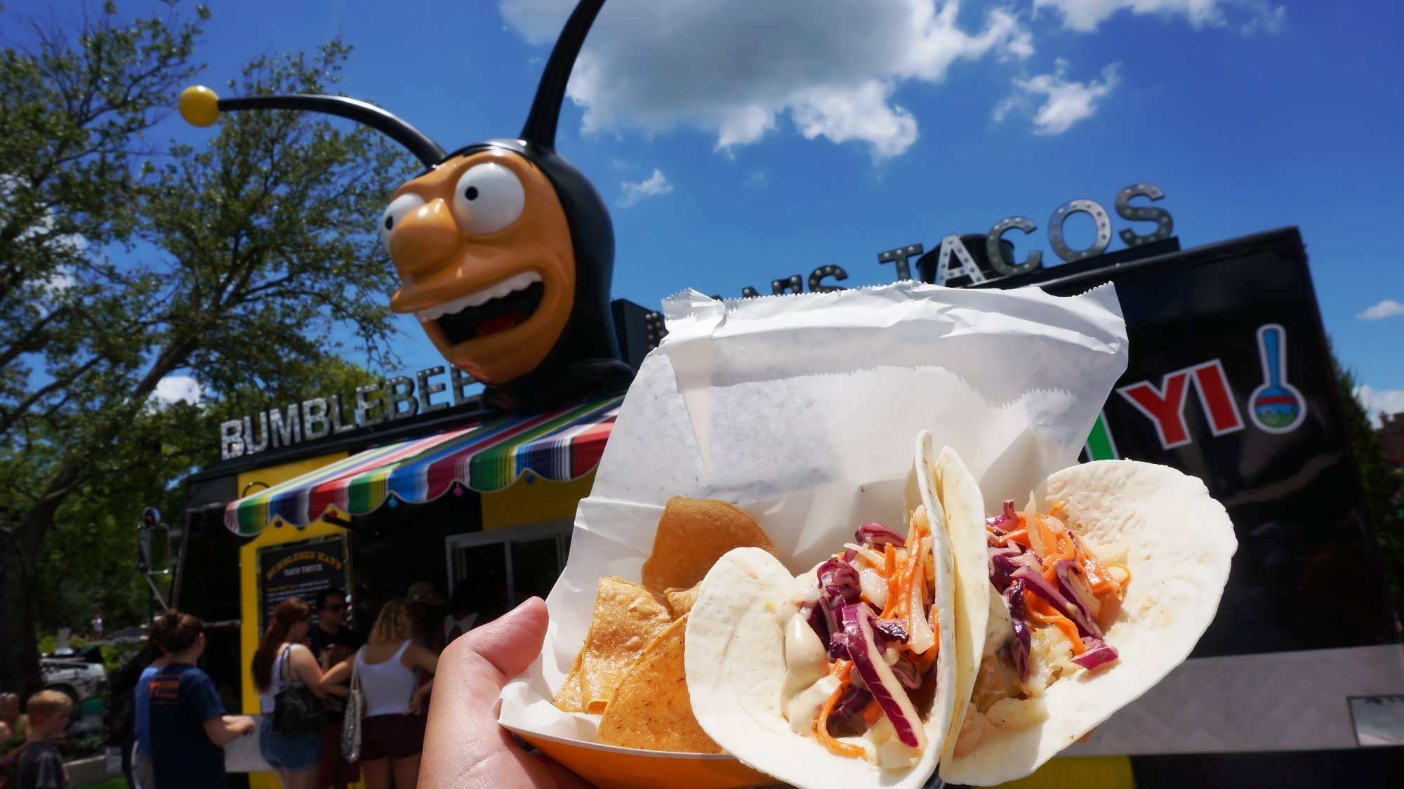 Two tacos and tortilla chips from Bumblebee Man's Taco Truck