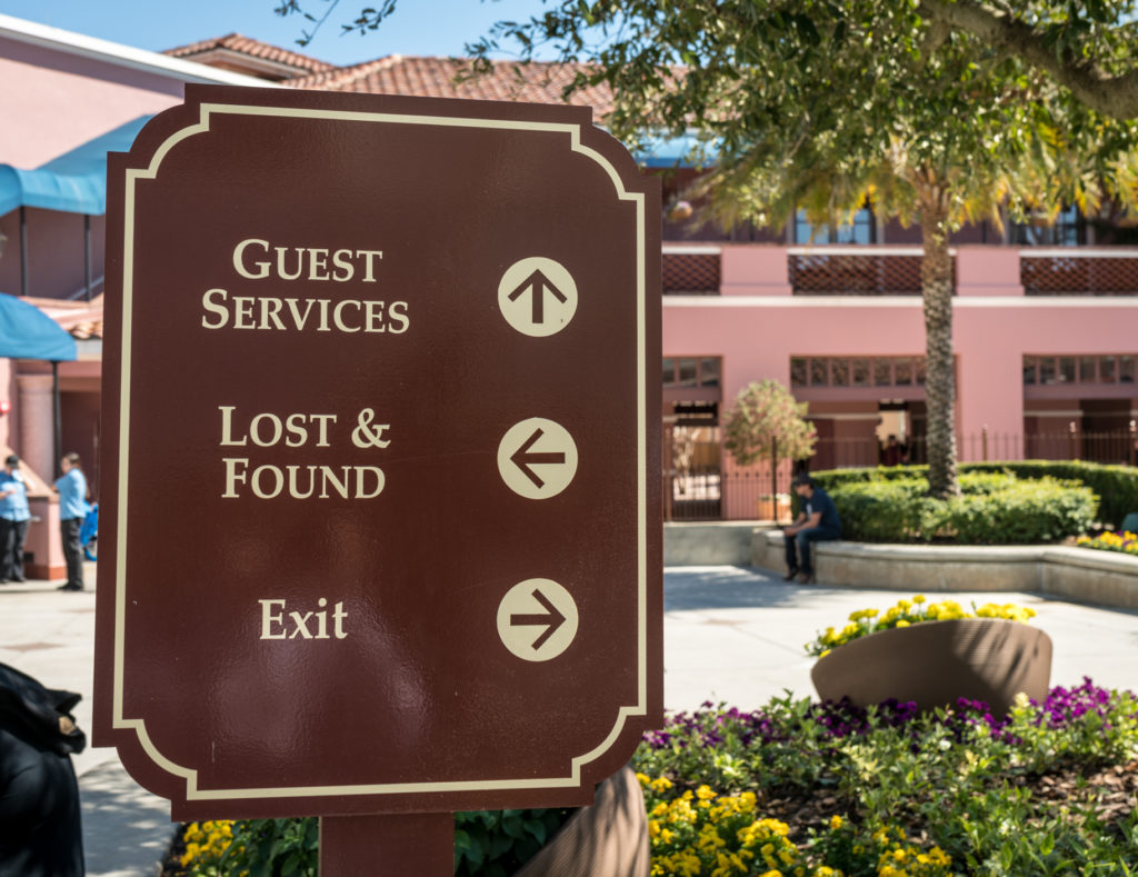 Sign pointing to guest services at Universal Studios Florida