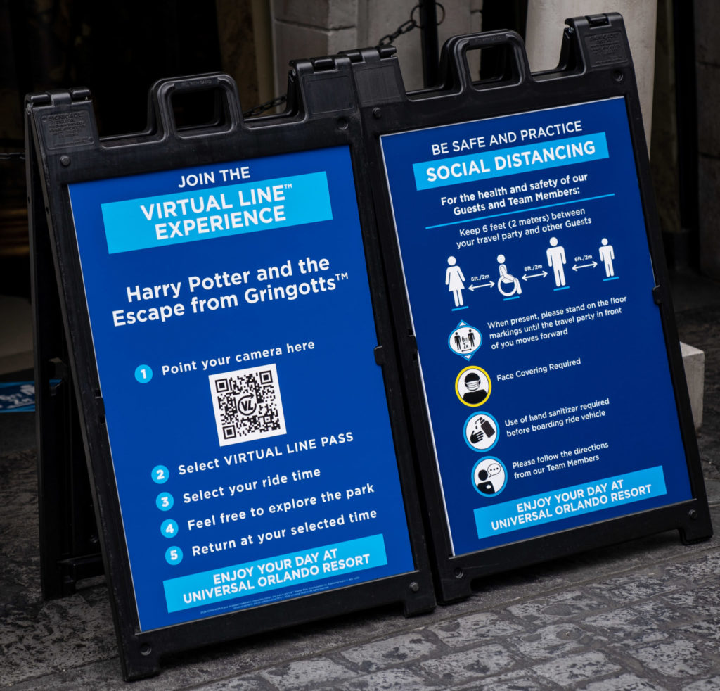 Signs detailing the virtual line experience at Universal Orlando Resort