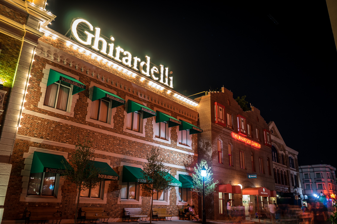Brick facade of the replica of Ghirardelli Square, with the sign in lights