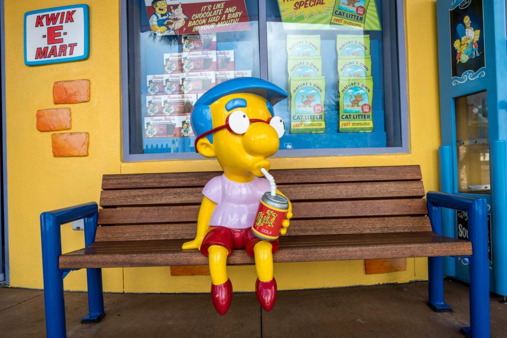 Milhouse outside of the Kiwk-E-Mart
