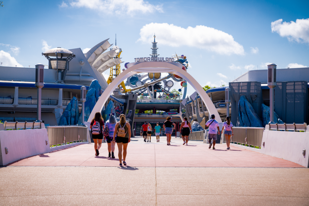 Guests arriving in Tomorrowland at Disney's Magic Kingdom