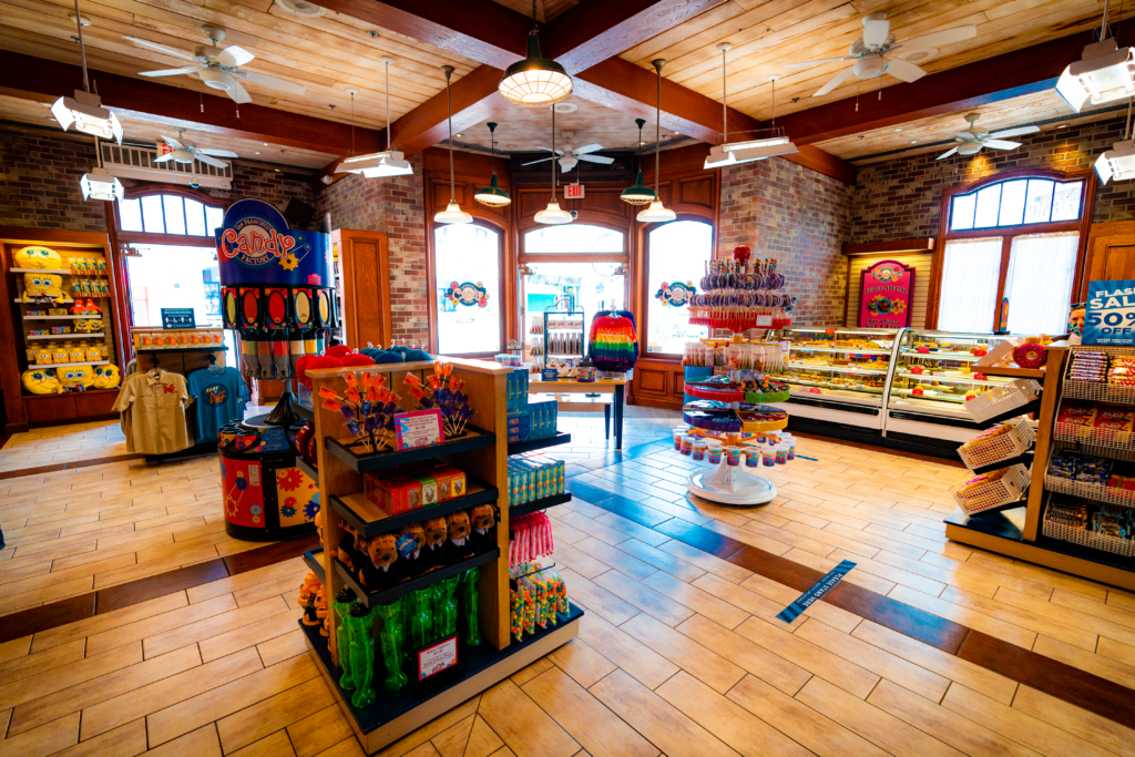 Interior of San Francisco Candy Factory has brightly-colored candy displays and a pastry counter