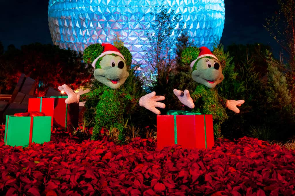 Mickey and Minnie holiday topiaries in front of Spaceship Earth at EPCOT