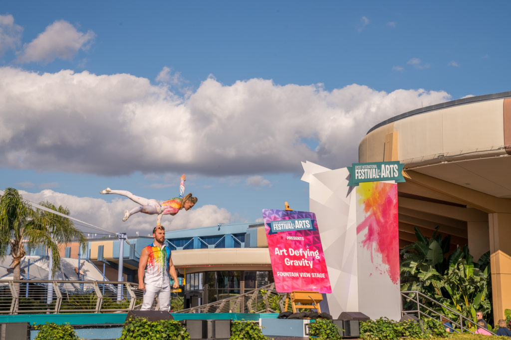 """Art Defying Gravity"" acrobats performing at EPCOT's Fountain View Stage"